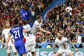 France's midfielder Paul Pogba scores the second goal for France as Iceland's midfielder Aron Gunnarsson looks on during the Euro 2016 quarterfinal...