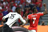 TOPSHOT France's midfielder Paul Pogba vies for the ball against Switzerland's forward Breel Embolo during the Euro 2016 group A football match...