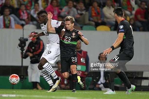 France's midfielder Paul Pogba vies with Portugal's midfielder Adrien Silva during the Friendly match between Portugal and France on September 04...