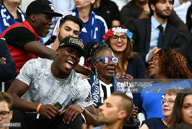France's midfielder Paul Pogba's mother Yeo Moriba and brothers Florentin and Mathias wait for the start of the Euro 2016 group A football match...