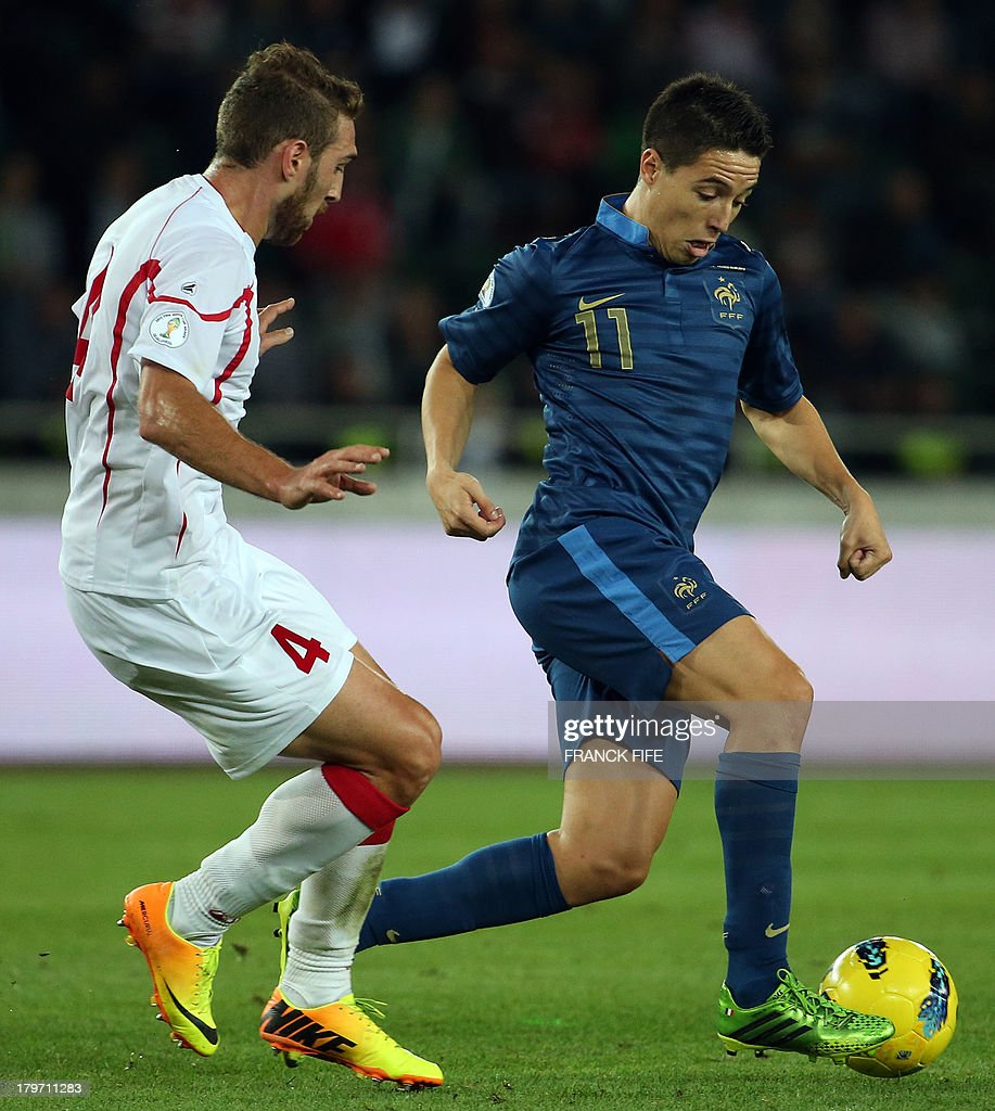 France's midfielder Samir Nasri (R) vies with Georgia's defender Guram Kashia during the FIFA World Cup 2014 qualifying football match Georgia vs France on September 6 2013 at the Boris Paichadze stadium in Tbilisi.