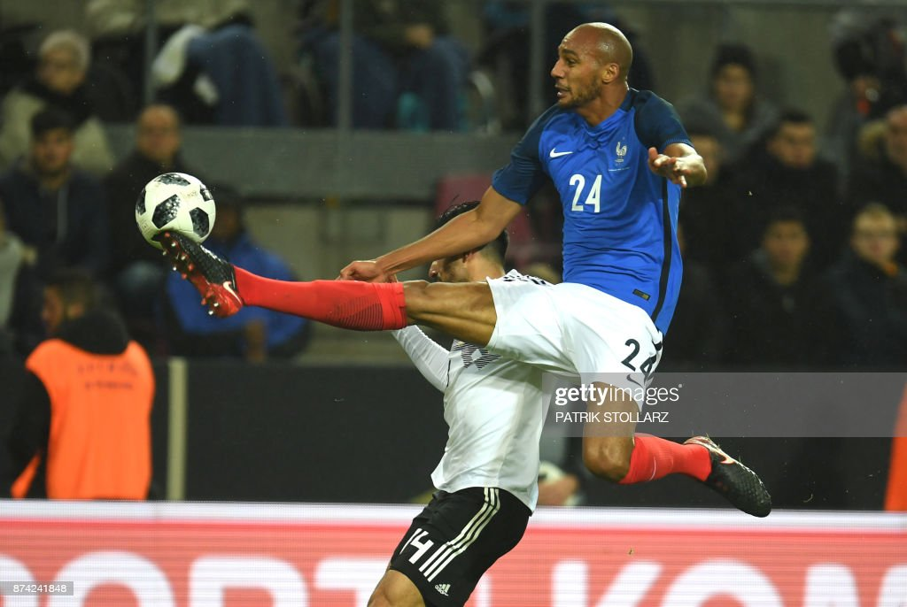 TOPSHOT - France's midfielder Steven N'Zonzi and Germany's midfielder Emre vie for the ball during the international friendly football match Germany against France in Cologne on November 14, 2017. The match ended 2-2. /