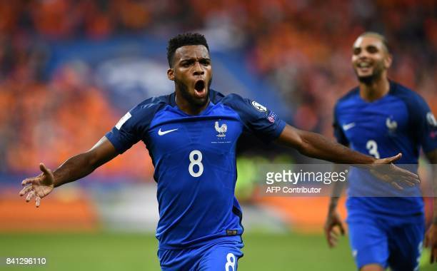 France's midfielder Thomas Lemar celebrates after scoring a goal during the 2018 FIFA World Cup qualifying football match France vs Netherlands at...