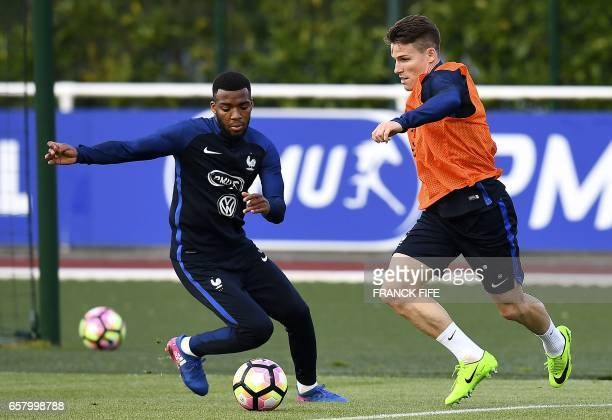 France's midfielder Thomas Lemar vies with France's forward Kevin Gameiro during a training session as part of the team's preparation for the...