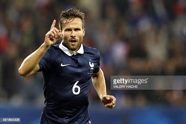France's midfielder Yohan Cabaye after scoring a goal during the friendly football match between France and Armenia on October 8 2015 at the Allianz...