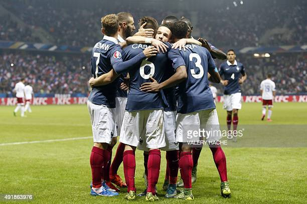 France's midfielder Yohan Cabaye celebrates with teammates after scoring a goal during the friendly football match between France and Armenia on...