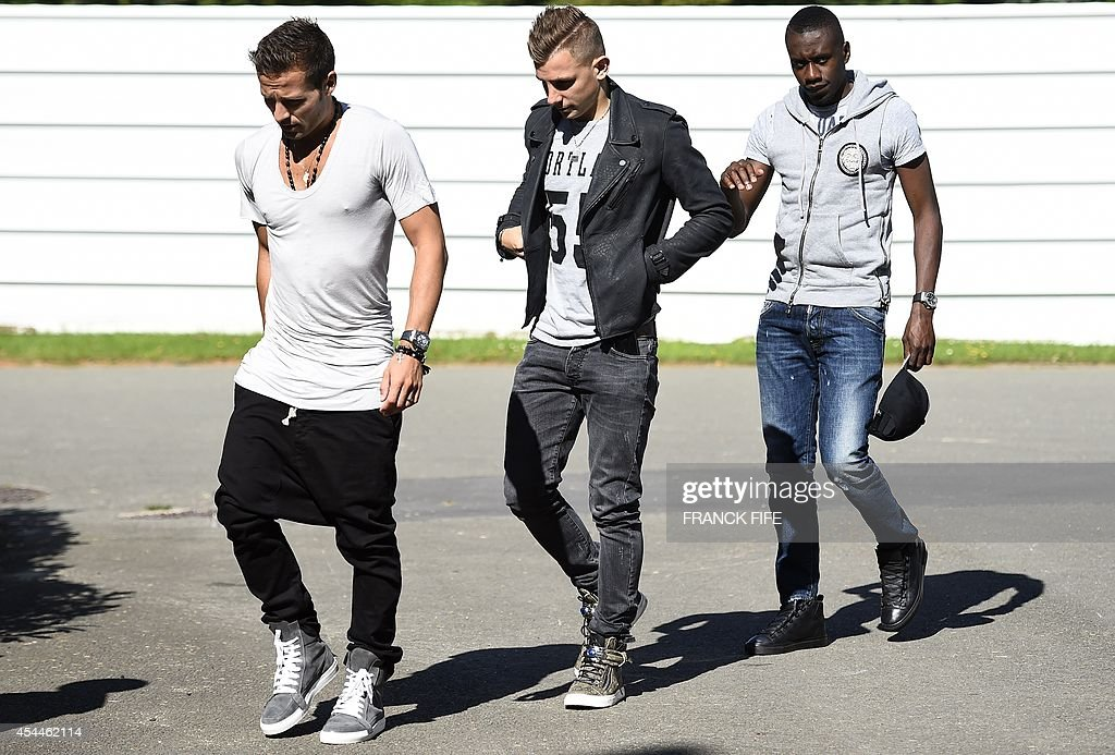 France's midfielder Yohan Cabaye, France's defender Lucas Digne and France's midfielder Blaise Matuidi arrive at the French national football team training base in Clairefontaine on September 1, 2014 on the first day of their training ahead of the friendly football match against Spain to be held on September 4.