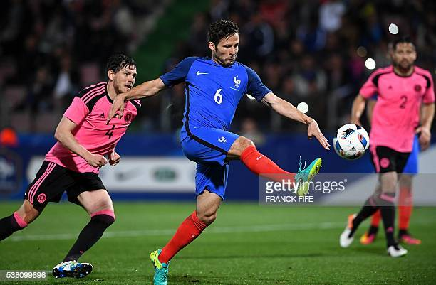 France's midfielder Yohan Cabaye kicks the ball ahead of Scotland's defender Gordon Greer during the friendly football match France vs Scotland at...