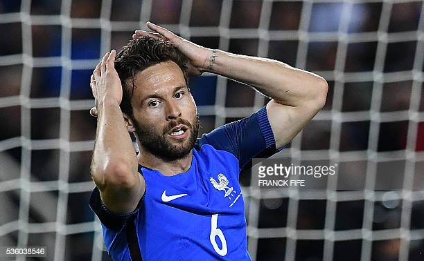 France's midfielder Yohan Cabaye reacts after missing a shot during the friendly football match between France and Cameroon at the Beaujoire Stadium...
