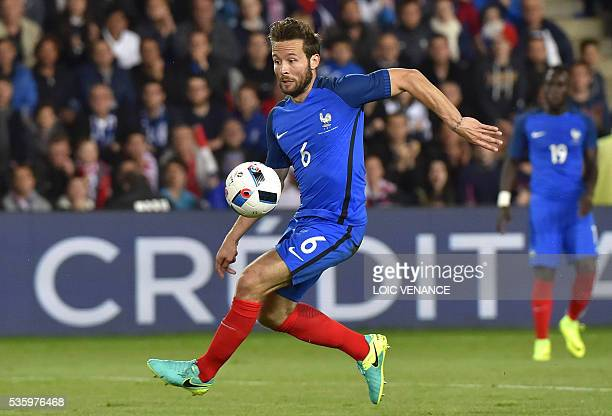 France's midfielder Yohan Cabaye runs with the ball during the International friendly football match between France and Cameroon at the Beaujoire...