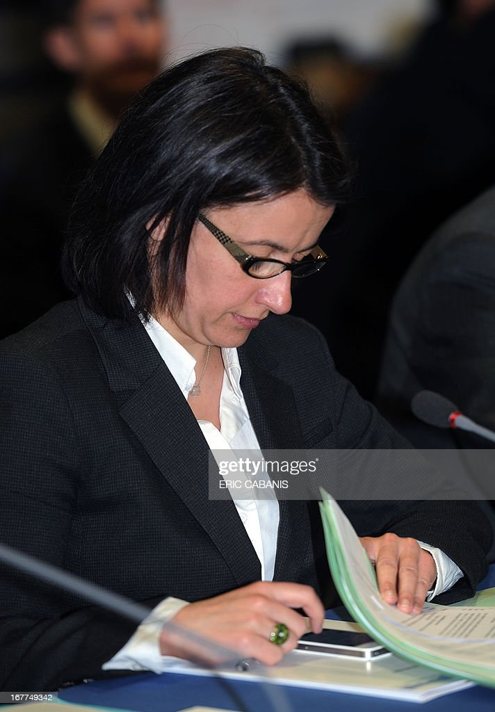 France's Minister for Equality of Territories and Housing Cecile Duflot uses her smartphone during a Mountain National Council (Conseil National de la Montagne) as part of a visit to the southern French department of Ariege on April 29, 2013 in Foix. AFP PHOTO / ERIC CABANIS