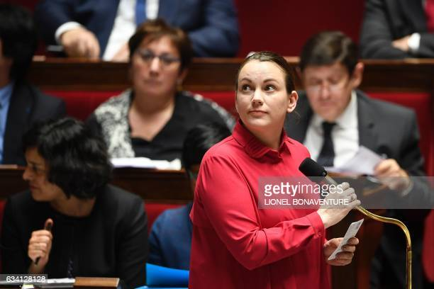 France's Minister of State for Digital Sector and Innovation Axelle Lemaire holds the microphone before speaking during a session of questions to the...
