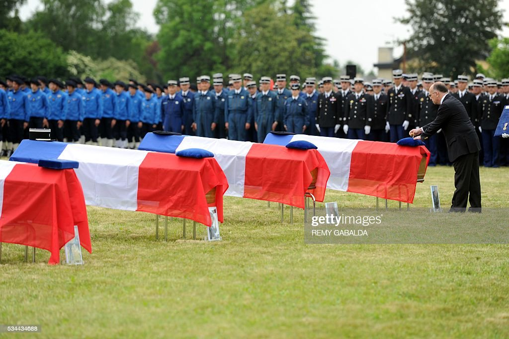 France's Minister of the Interior Bernard Cazeneuve pays hommage during the funeral of four mountain rescue specialist police officers, killed after a helicopter crash in the Cauteret region of the Pyrenees mountains, on May 26, 2016 in Tarbes. Four French police were killed May 20 when their helicopter crashed in the Pyrenees, in one of the deadliest such incidents in recent years. The dead, who were all in their 40s, included the pilot, co-pilot and two mountain rescue specialists involved in a training exercise, local authorities said. GABALDA
