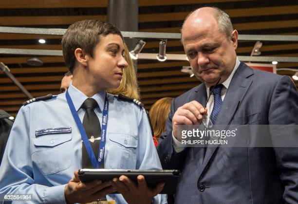France's Minister of the Interior Bruno Le Roux looks on during a presentation of a tabletcomputer security system on January 24 2017 in Lille during...