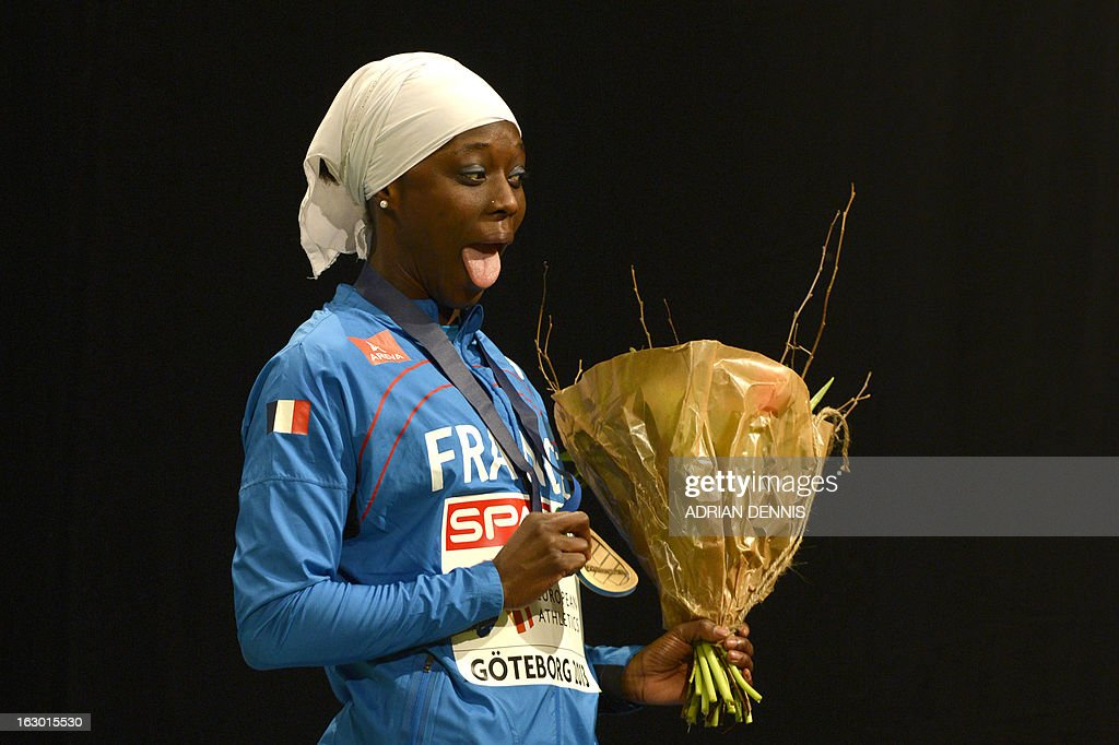 France's Myriam Soumaré celebrates on the podium with her bronze medal after the women's 60m final at the European Indoor Athletics Championships in Gothenburg, Sweden, on March 3, 2013.