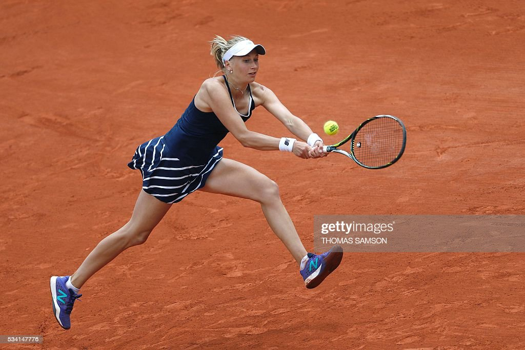 France's Myrtille Georges returns the ball to Spain's Garbine Muguruza during their women's second round match at the Roland Garros 2016 French Tennis Open in Paris on May 25, 2016. / AFP / Thomas SAMSON