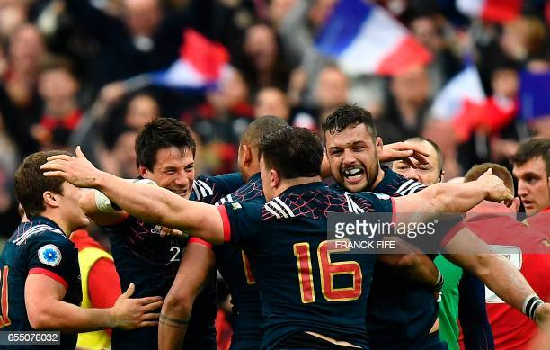 Frances N°8 Damien Chouly is congratueld by teammates after scoring a try during the Six Nations international rugby union match between France and...