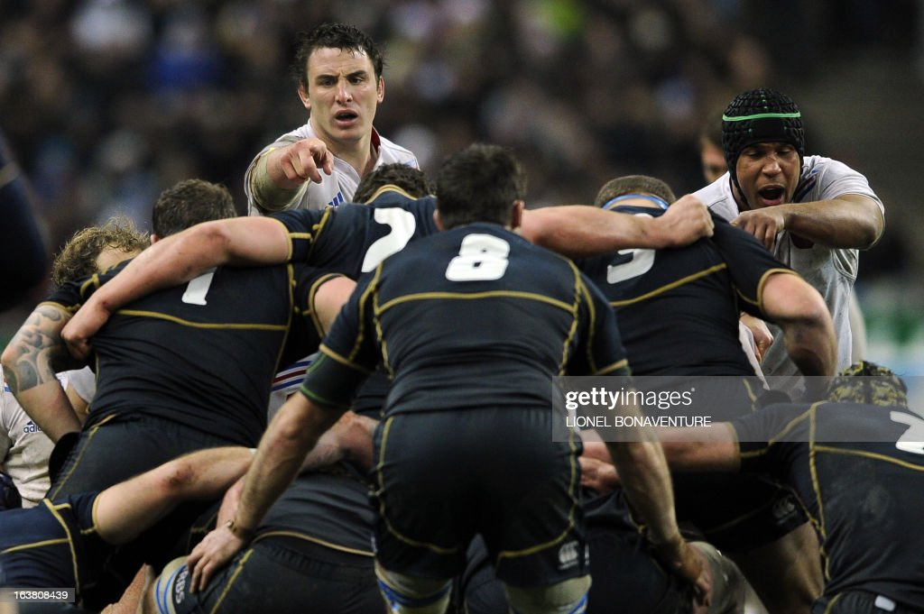 France's N°8 Louis Picamoles and France's captain Thierry Dusautoir (back R) prepare for a scrum during the Six Nations International Rugby Union match between France and Scotland at the Stade de France, in Saint-Denis, near Paris on March 16, 2013.