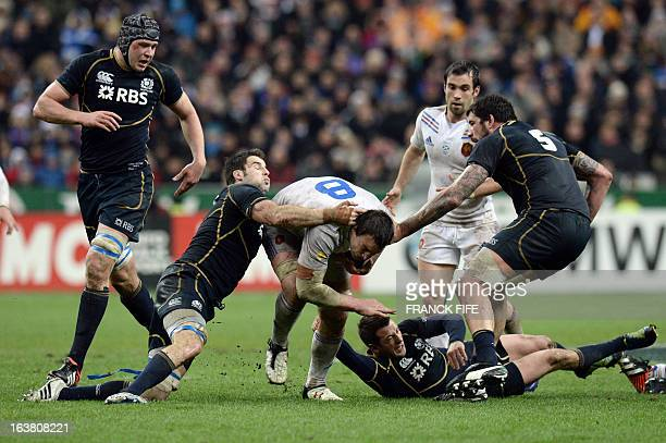 France's N°8 Louis Picamoles tries to break through the Scottish defence during the Six Nations International Rugby Union match between France and...