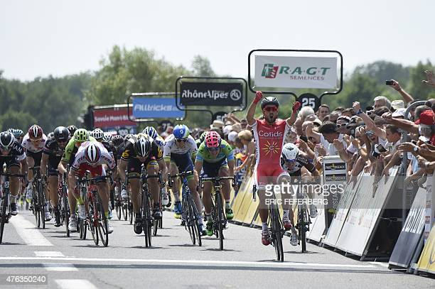 France's Nacer Bouhanni celebrates as he crosses the finish line at the end of the 173 km second stage of the 67th edition of the Dauphine Criterium...