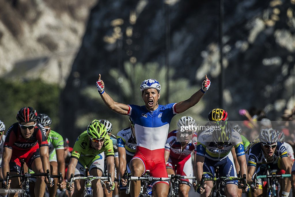 France's Nacer Bouhanni of FDJ team celebrates after he crossed the finish line and won the sixth and last stage of the cycling Tour of Oman, on February 16, 2013, in the Omani capital Muscat. The final stage was a 144km ride from Hawit Nagam park in the south of the emirate to Muscat along the Matrah corniche. Bouhanni won the stage and Britain's Christopher Froome (Sky Procycling) won the Tour. AFP PHOTO / JEFF PACHOUD
