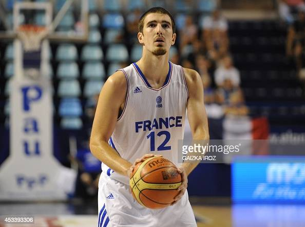 France's Nando De Colo concentrates prior a free throw during the friendly basketball match France vs Greece on August 9 in Pau southwestern France...