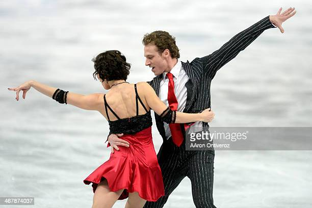 France's Nathalie Pechalat and Fabian Bourzat perform their routine in ice dance short en route to a 6915 during team figure skating Sochi 2014...