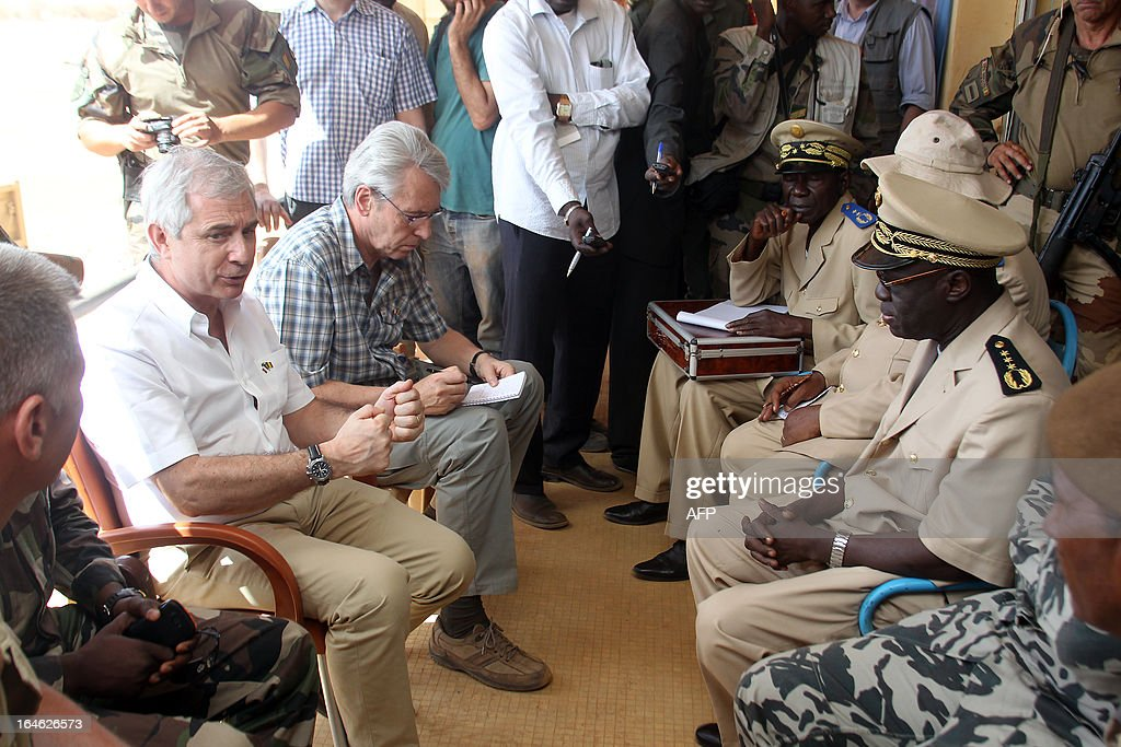 France's national assembly president Claude Bartolone (L) meets Gao's governor Mamadou Adama Giallo on March 25, 2013 in Gao, during a visit to the war-torn west African nation of Mali. Bartolone praised 'the work of French troops, their courage and determination' as he met soldiers in Gao, the largest city in northern Mali which was liberated after being occupied by Al Qaeda-linked militants last year. KOUYATE