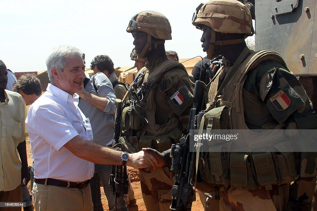 France's national assembly president Claude Bartolone reviews troops fighting Islamists in Mali on March 25, 2013 in Gao, during a visit to the war-torn west African nation. Bartolone praised 'the work of French troops, their courage and determination' as he met soldiers in Gao, the largest city in northern Mali which was liberated after being occupied by Al Qaeda-linked militants last year. KOUYATE