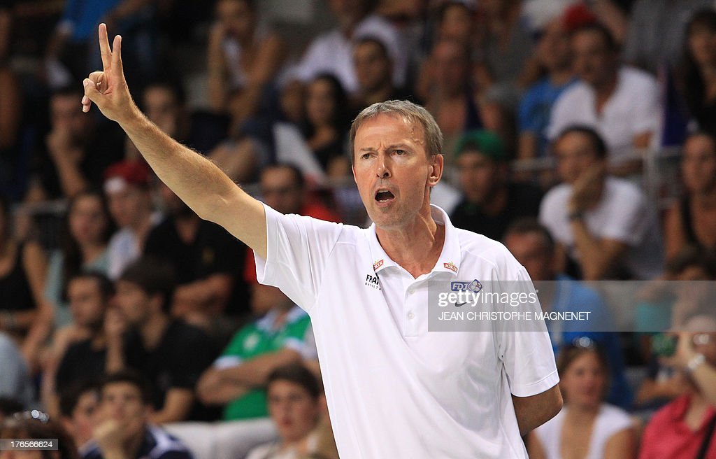 France's national basketball team head coach Vincent Collet gestures during a friendly basketball match between France and Serbia on August 15, 2013 in Antibes, southeastern France as part of the preparation for the 2013 EuroBasket in Slovenia.
