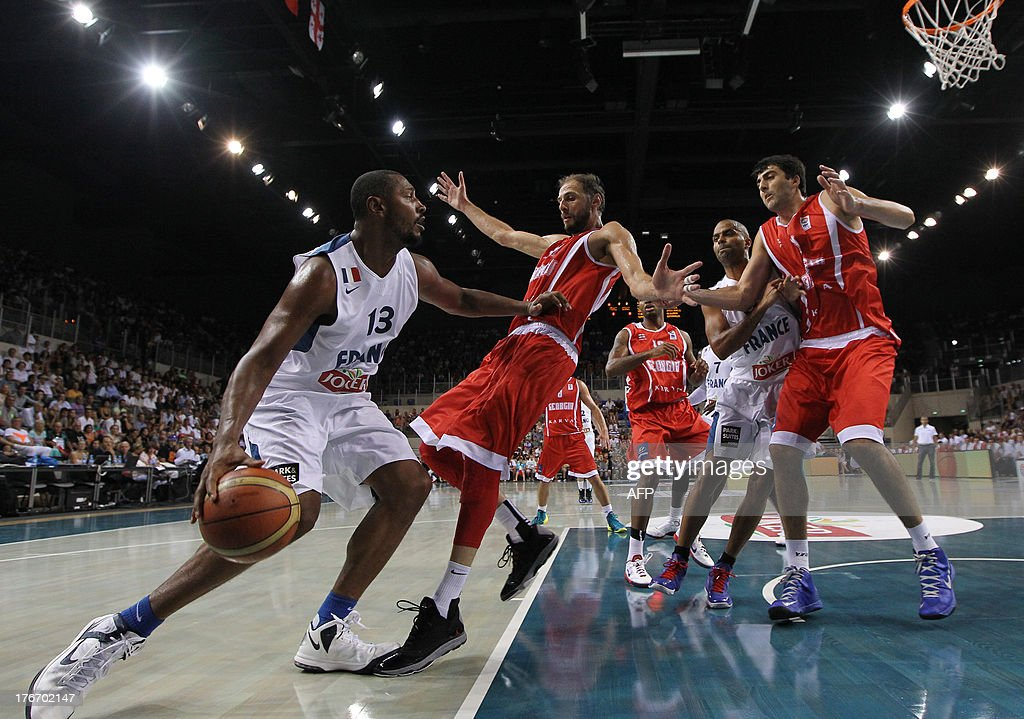 France's national basketball team player Boris Diaw (L) vies with Georgia's national basketball team player Viktor Sanikidze (C), during the friendly basketball match France vs Georgia, on August 17, 2013, in Antibes, southeastern France, as part of the preparation for the 2013 EuroBasket in Slovenia.