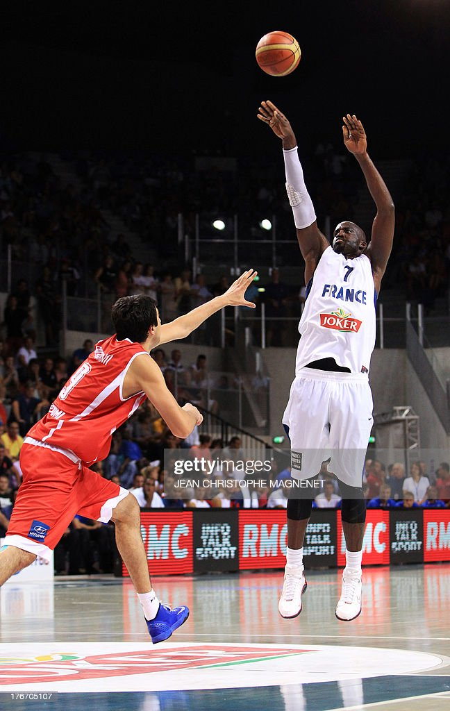 France's national basketball team player Johan Pietro (R) is challenged by Georgia's national basketball team player Giorgi Shermadini (L) during the friendly basketball match France vs Georgia, on August 17, 2013, in Antibes, southeastern France, as part of the preparation for the 2013 EuroBasket in Slovenia.