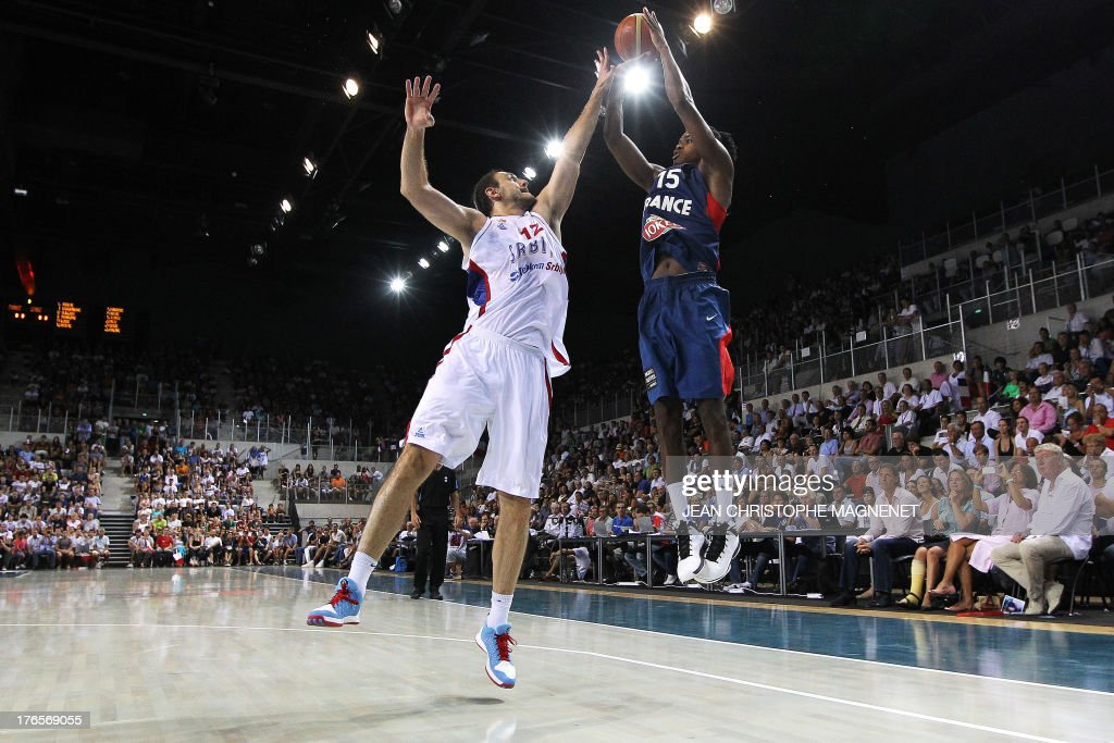 France's national basketball team player Mickael Gelabale (R) is challenged by Serbia's Nend Krstic (L) during a friendly basketball match between France and Serbia on August 15, 2013 in Antibes, southeastern France as part of the preparation for the 2013 EuroBasket in Slovenia.