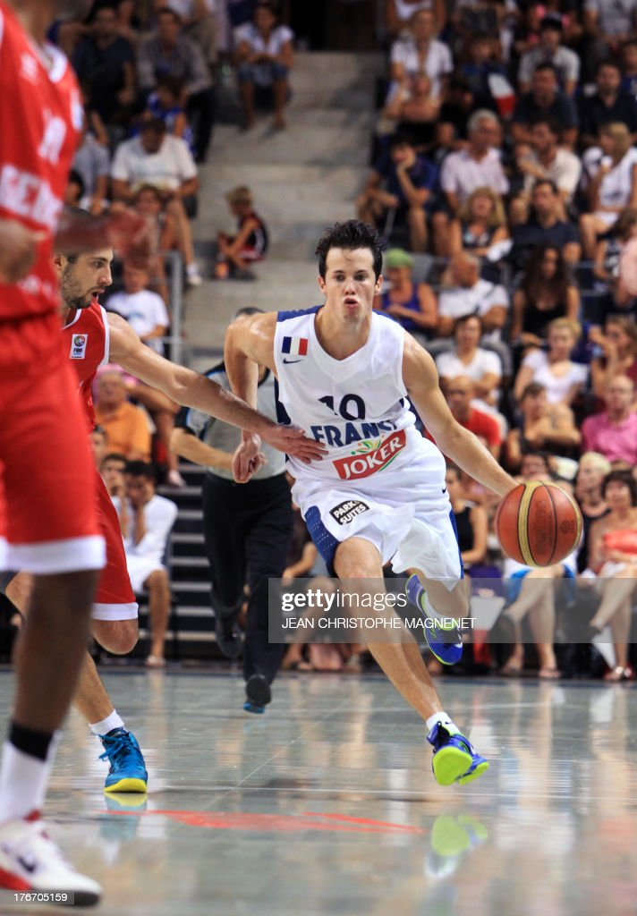 France's national basketball team player Thomas Heurtel dribbles the ball during the friendly basketball match France vs Georgia, on August 17, 2013, in Antibes, southeastern France, as part of the preparation for the 2013 EuroBasket in Slovenia.