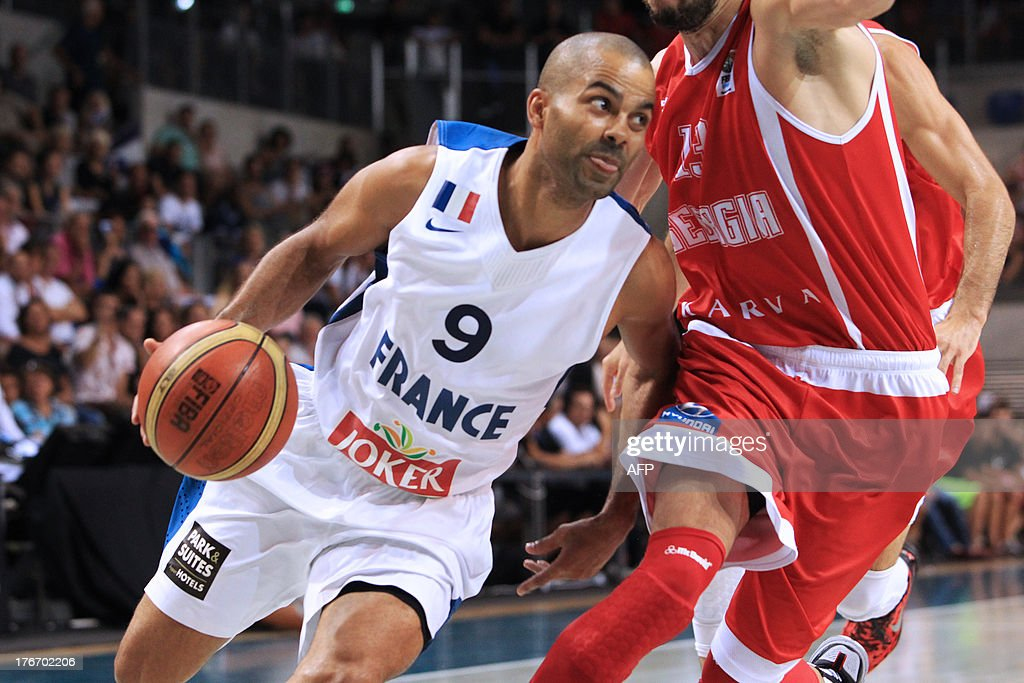 France's national basketball team player Tony Parker (L) vies with Georgia's national basketball team player Viktor Sanikidze (R), during the friendly basketball match France vs Georgia, on August 17, 2013, in Antibes, southeastern France, as part of the preparation for the 2013 EuroBasket in Slovenia. AFP PHOTO / JEAN CHRISTOPHE MAGNENET