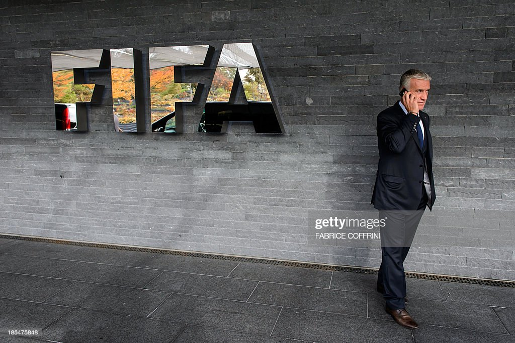 France's national football team coach Didier Deschamps gives a phone on October 21, 2013 after attending the draw for the 2014 FIFA World Cup European zone play-off matches held at the headquarters of the football's world governing body in Zurich. The play-off matches are due to be played on November 15 and 19.