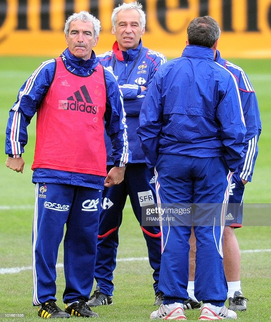 France's national football team coach Raymond Domenech gestures next to assistant coach Pierre Mankowski, doctor Alain Simon and assistant coach Alain Boghossian during a team training session ahead of the 2010 FIFA World Cup on June 6, 2010 in Knysna.