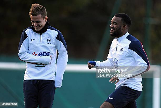 France's national football team forwards Antoine Griezmann and Alexandre Lacazette take part in a training session two days before the team's...