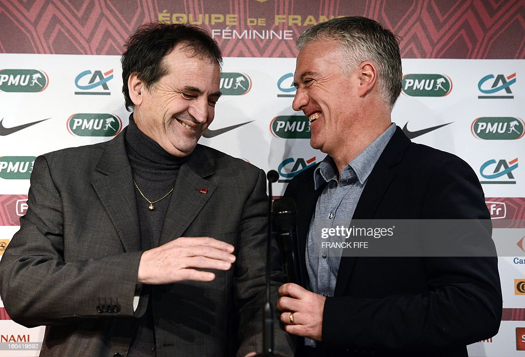 France's national football team head coach Didier Deschamps (R) and France's women national football team head coach Bruno Bini share a laugh as they give a press conference on January 31, 2013 to announce their squad for the friendly football matches against Germany next February 6, at the French Football Federation (FFF) headquarters in Paris. AFP PHOTO / FRANCK FIFE
