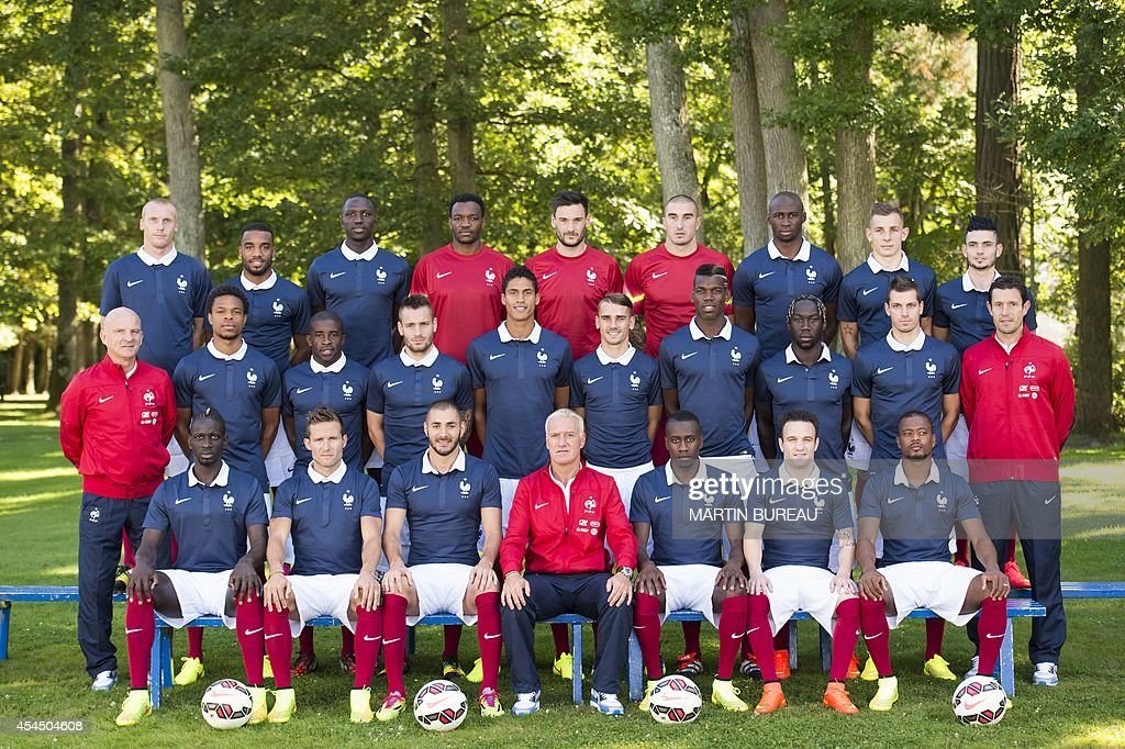 France's national football team members (from L-Up) defender Jeremy Mathieu, forward Alexandre Lacazette, midfielder Moussa Sissoko, goalkeeper Steve Mandanda, goalkeeper Hugo Lloris, goalkeeper Stephane Ruffier, defender Eliaquim Mangala, defender Lucas Digne and midfielder Remy Cabella, (center-from L) assistant coach Guy Stephan, forward Loic Remy, midfielder Rio Mavuba, defender Mathieu Debuchy, defender Raphael Varane, forward Antoine Griezmann, midfielder Paul Pogba, defender Bakary Sagna, midfielder Morgan Schneiderlin and goalkeeper coach Franck Raviot, (down-from L) France's defender Mamadou Sakho, midfielder Yohan Cabaye, forward Karim Benzema, head coach Didier Deschamps, midfielder Blaise Matuidi, midfielder Mathieu Valbuena and defender Patrice Evra pose in Clairefontaine-en-Yvelines on September 2, 2014.