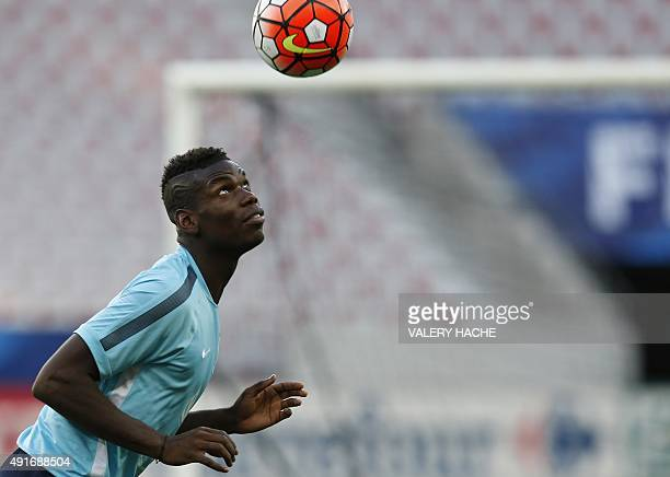 France's national football team midfielder Paul Pogba attends a training session on the eve of the friendly football match France vs Armenia on...