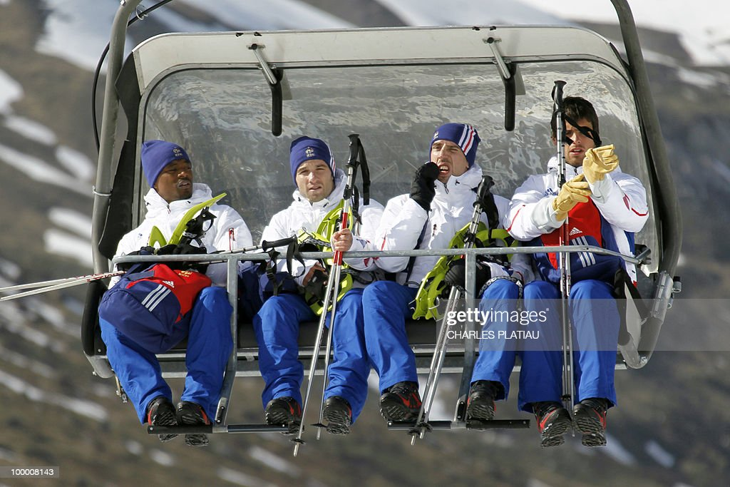 France's national football team players Patrice Evra, Mathieu Valbuena, Franck Ribery and Yoann Gourcuff sit in a ski lift to reach the Tignes glacier on May 19, 2010 in the French Alps. The French national team should sleep in altitude tonight and climb up the glacier on May 20, if weather permitting, as part of their altitude training in preparation for the 2010 World cup in South Africa.