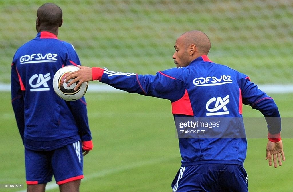 France's national football team striker Thierry Henry controls a ball with his left hand during a team training session ahead of the 2010 FIFA World Cup on June 6, 2010 in Knysna.