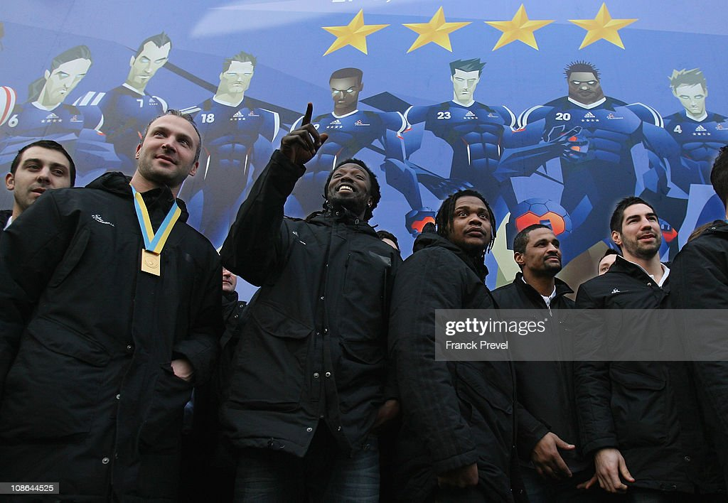 France's national handball team players (L-R) Mickael Guigou, <a gi-track='captionPersonalityLinkClicked' href=/galleries/search?phrase=Thierry+Omeyer&family=editorial&specificpeople=853674 ng-click='$event.stopPropagation()'>Thierry Omeyer</a>, <a gi-track='captionPersonalityLinkClicked' href=/galleries/search?phrase=Daouda+Karaboue&family=editorial&specificpeople=853768 ng-click='$event.stopPropagation()'>Daouda Karaboue</a>, Cedric Sorhaindo, <a gi-track='captionPersonalityLinkClicked' href=/galleries/search?phrase=Didier+Dinart&family=editorial&specificpeople=710241 ng-click='$event.stopPropagation()'>Didier Dinart</a>, Nikola Karabatic celebrate their victory at Champs-Elysees on January 31, 2011 in Paris, France. France's handball wins the World Championship final against Denmark. France won 37-35, making them the first country to win four successive major titles in the sport.