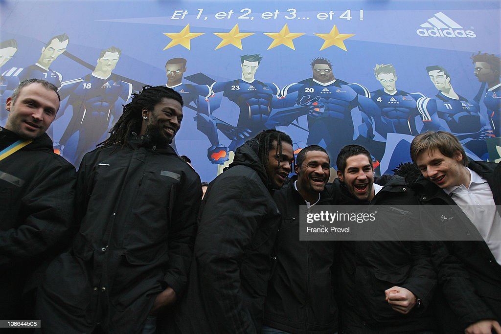 France's national handball team players (L-R) <a gi-track='captionPersonalityLinkClicked' href=/galleries/search?phrase=Thierry+Omeyer&family=editorial&specificpeople=853674 ng-click='$event.stopPropagation()'>Thierry Omeyer</a>, <a gi-track='captionPersonalityLinkClicked' href=/galleries/search?phrase=Daouda+Karaboue&family=editorial&specificpeople=853768 ng-click='$event.stopPropagation()'>Daouda Karaboue</a>, Cedric Sorhaindo, <a gi-track='captionPersonalityLinkClicked' href=/galleries/search?phrase=Didier+Dinart&family=editorial&specificpeople=710241 ng-click='$event.stopPropagation()'>Didier Dinart</a>, Nikola Karabatic and Xavier Barachet celebrate their victory at Champs-Elysees on January 31, 2011 in Paris, France. France's handball wins the World Championship final against Denmark. France won 37-35, making them the first country to win four successive major titles in the sport.