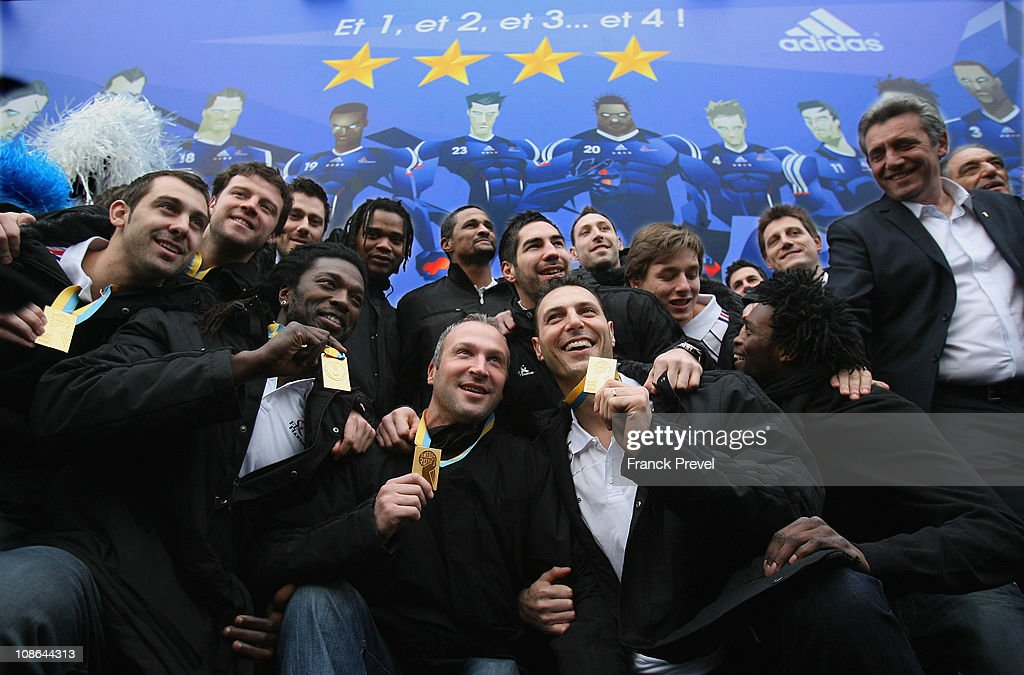 France's national handball team, ( 1st row, L-R) Thierry Omeyer, <a gi-track='captionPersonalityLinkClicked' href=/galleries/search?phrase=Jerome+Fernandez&family=editorial&specificpeople=791049 ng-click='$event.stopPropagation()'>Jerome Fernandez</a>, Team Capitain; (2nd row, L-R) Daouda Karaboué, Nicolas Karabatic, Xavier Barachet, Arnaud Bingo and coach <a gi-track='captionPersonalityLinkClicked' href=/galleries/search?phrase=Claude+Onesta&family=editorial&specificpeople=792495 ng-click='$event.stopPropagation()'>Claude Onesta</a>; (3rd row, L-R) Mickael Guigou, Guillaume Joli, Sebastien Bosquet, Cedric Sorhaindo, <a gi-track='captionPersonalityLinkClicked' href=/galleries/search?phrase=Daniel+Narcisse&family=editorial&specificpeople=791032 ng-click='$event.stopPropagation()'>Daniel Narcisse</a>, Franck Junillon celebrate victory at Champs-Elysees on January 31, 2011 in Paris, France. France's handball wins the World Championship final against Denmark. France won 37-35, making them the first country to win four successive major titles in the sport.