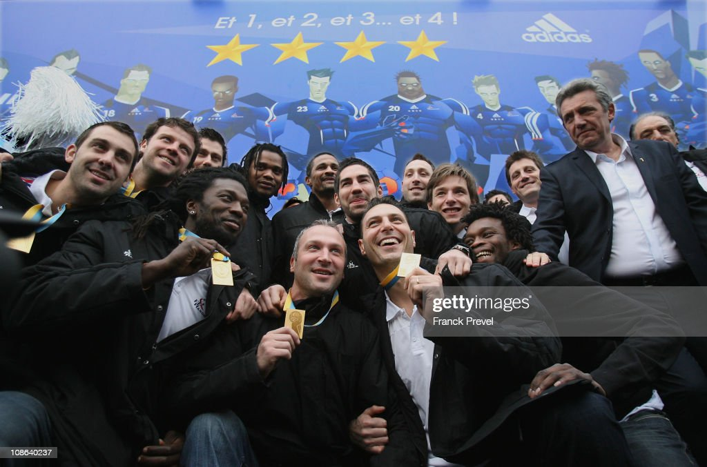 France's national handball team, (1st row, L-R) Thierry Omeyer, Team Capitain <a gi-track='captionPersonalityLinkClicked' href=/galleries/search?phrase=Jerome+Fernandez&family=editorial&specificpeople=791049 ng-click='$event.stopPropagation()'>Jerome Fernandez</a>; (2nd row L-R) Daouda Karaboué, Nicolas Karabatic, Xavier Barachet, Arnaud Bingo and coach <a gi-track='captionPersonalityLinkClicked' href=/galleries/search?phrase=Claude+Onesta&family=editorial&specificpeople=792495 ng-click='$event.stopPropagation()'>Claude Onesta</a>; (3rd row L-R) Mickael Guigou, Guillaume Joli, Sebastien Bosquet, Cedric Sorhaindo, <a gi-track='captionPersonalityLinkClicked' href=/galleries/search?phrase=Daniel+Narcisse&family=editorial&specificpeople=791032 ng-click='$event.stopPropagation()'>Daniel Narcisse</a>, Franck Junillon celebrate victory at Champs-Elysees on January 31, 2011 in Paris, France. France's handball team won the World Championship final beating Denmark 37-35, making them the first country to win four successive major titles in the sport.