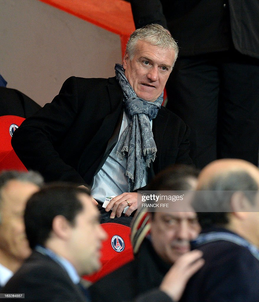 France's national head coach Didider Deschamps sits in the stands during the UEFA Champions League round of 16 second leg football match between Paris Saint-Germain and Valencia at the Parc des Princes stadium in Paris, on March 6, 2013.