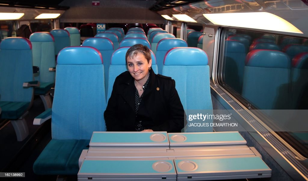 France's national rail company SNCF director of the 'Ouigo' project Valerie Dehlinger poses inside the new low-cost TGV high-speed train 'Ouigo' at the Marne-La-Vallee railway station ouside Paris on February 19, 2013, during its presentation to the press. France's state rail firm SNCF opened its online booking service for its new budget train service 'Ouigo' on February 19 inspired by the budget airline model. The train will start transporting its first passengers from April 2, with the Ouigo service operating from Marne-la-Vallée near Disneyland Paris, Lyon-Saint-Exupéry airport, Marseilles and Montpellier.