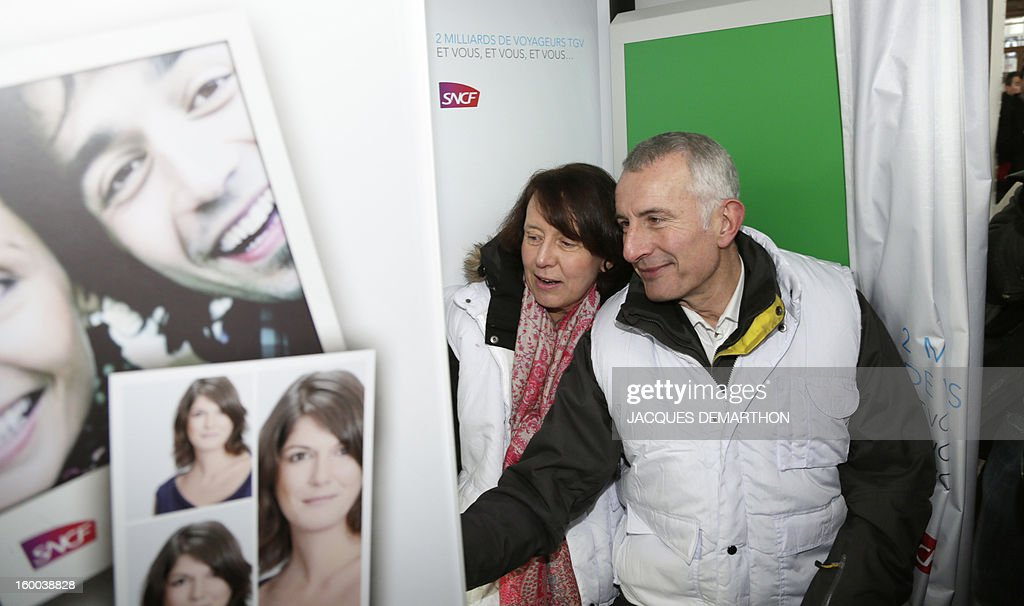 France's national rail company SNCF head, Guillaume Pepy (R), and General Director of SNCF Voyages, Barbara Dalibard, take a picture of themselves in a photobooth at the Gare de Lyon railways station on January 25, 2013 in Paris, during the celebration of the 2 billionth traveler of the company.